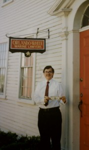 Attorney White, holding the first dollar made at the Orlando & White office in New Bedford, 1984.